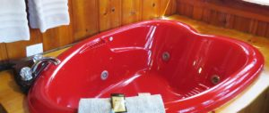 Red heart-shaped jetted tub
