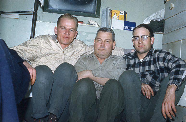 Three men sitting together for a picture