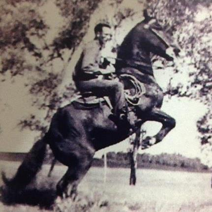 Man riding horseback