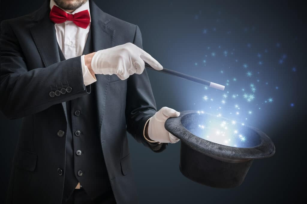 Magician with magic wand and top hat