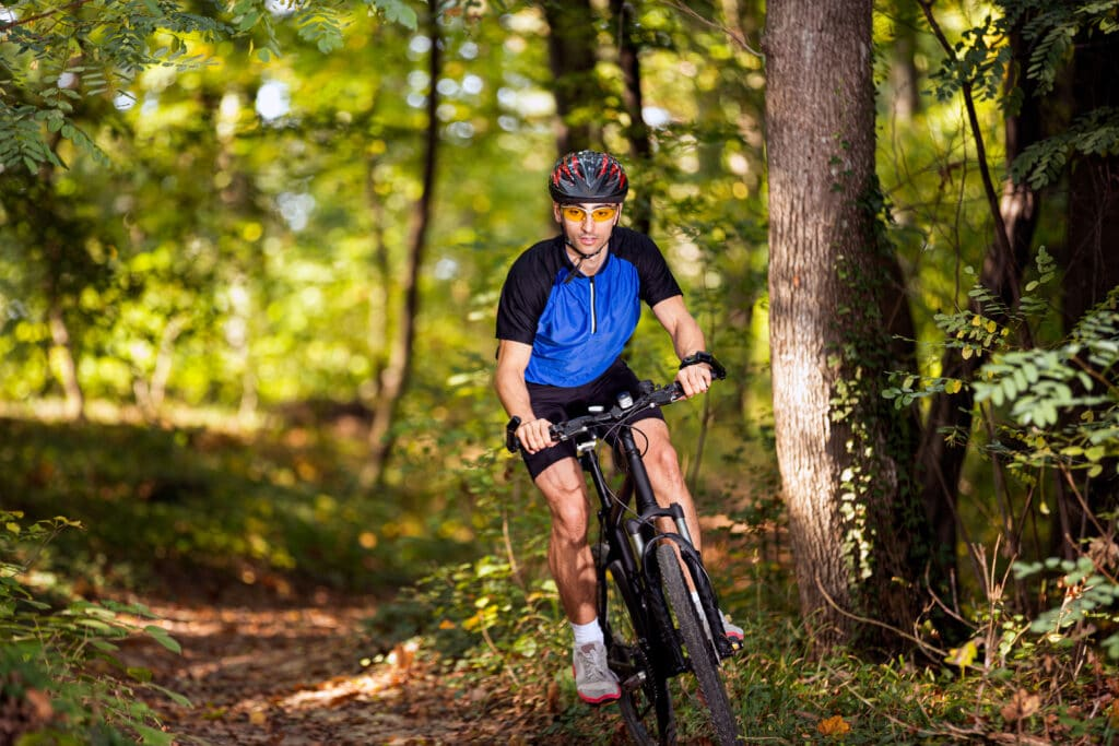 Man on mountain bike in forest
