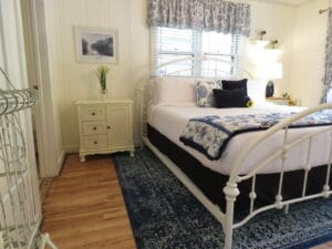cabin with hardwood floors a king iron bed